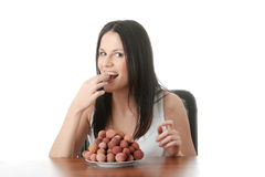 Eating litchi fruits Royalty Free Stock Photography