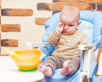 Eating little boy is looking very angry Royalty Free Stock Photo