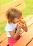 Eating little girl Stock Photos