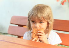 Eating little girl Royalty Free Stock Image