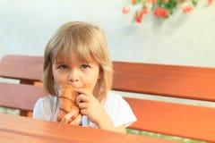 Eating little girl Stock Image