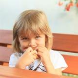 Eating little girl Royalty Free Stock Photo