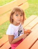 Eating little girl Stock Images