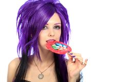 Eating lollipop royalty free stock photography