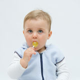 Eating lollipop Royalty Free Stock Photo