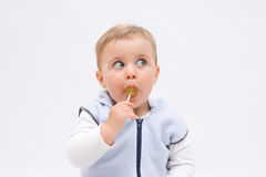 Eating lollipop. Cute, little, boy eating a lollipop stock photo