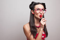 Eating lollipop stock photo