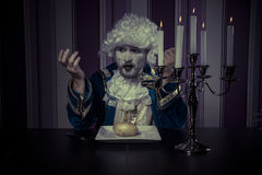 Eating, man dressed in rococo style, concept of wealth and pover Royalty Free Stock Image