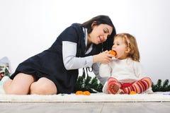 Eating Mandarin Royalty Free Stock Photo