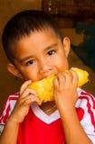 Eating mango Stock Image