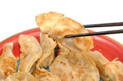 Eating meat dumpling. Macro chinese meat dumpling and chopsticks Royalty Free Stock Image