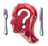 Eating Meat Questions. Concept or diet and nutrition decisions as a red steak with a question mark cut out of the raw food with a dinner table setting with a stock illustration