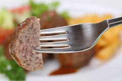 Eating meatballs with a fork Stock Photos