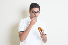 Eating medicine pill Royalty Free Stock Photo