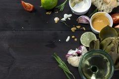Eating Mediterranean, artichoke with dips, garlic, tomatoes, lem Stock Image