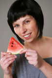 Eating melon stock images