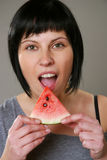 Eating melon royalty free stock photos
