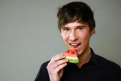 Eating melon stock photo