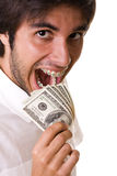 Eating the money Royalty Free Stock Image