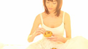 Eating A Muffin In Bed stock footage