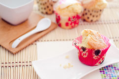 Eating muffins. A snack consisting of muffins accompanied by a cup of coffee Royalty Free Stock Images