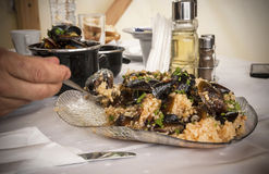 Eating mussels with rice Royalty Free Stock Image
