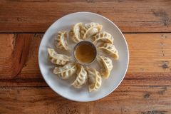 Eating Nepalese Traditional Dish Momo. Authentic Cuisine in Nepal