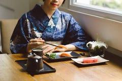 Eating nigiri sushi Stock Photo