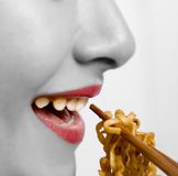 Eating noodles Stock Image