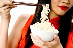 Eating noodles Royalty Free Stock Images