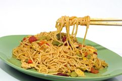 Eating noodles with chopsticks Royalty Free Stock Image