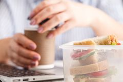 Eating in the office. Close up royalty free stock image