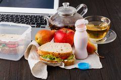 Eating in the office. With sandwich royalty free stock photo