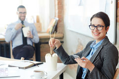 Eating in office Royalty Free Stock Photography