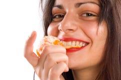 Eating orange Royalty Free Stock Photography