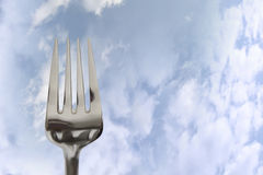 Eating out fork isolated in clouds Royalty Free Stock Photos