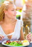 Eating in outdoors restaurant Stock Photography