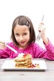 Eating pancake Stock Images