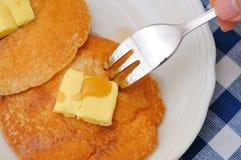 Eating pancake with fork Royalty Free Stock Photos