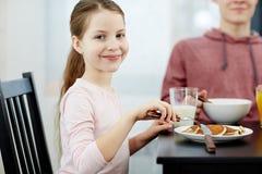 Eating pancakes Royalty Free Stock Image