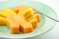 Eating Papaya  and Mango. Eating Papaya and Mango are sweet and a little acid . They gives you strong and healthy Royalty Free Stock Images