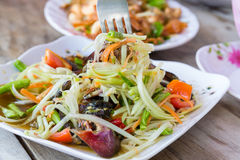 Eating papaya spicy seafood salad Stock Image