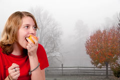 Eating a Peach Stock Image