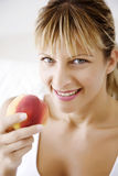 Eating peach stock images