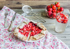 Eating a piece of rye biscuit with fresh strawberries, summer pi Stock Image