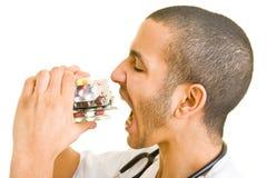 Eating pills stock photography