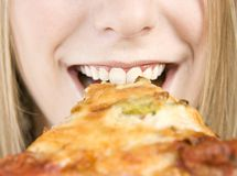 Eating Pizza Stock Images