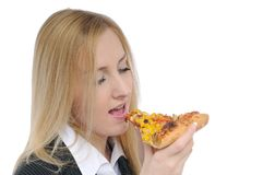 Eating pizza stock image