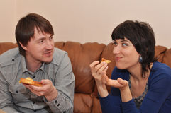 Eating pizza is fun! royalty free stock photography
