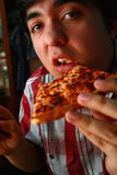 Eating Pizza. A man eats a slice of pizza Royalty Free Stock Image